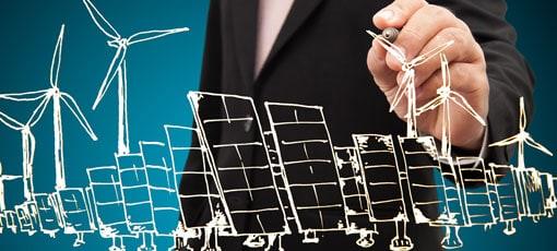 Mann zeichnet Windräder und Solarmodule