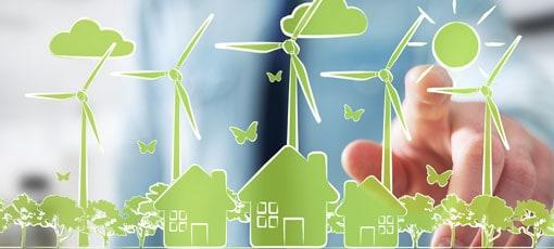 Gezeichnete Häuser im Grünen dahinter stehen Windräder